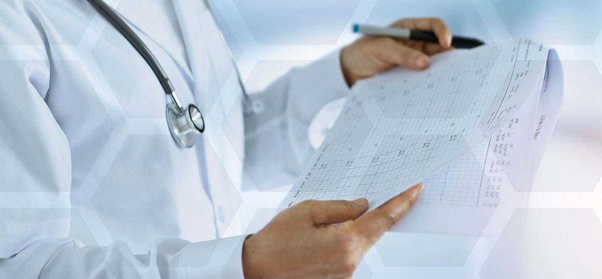 doctor looking at report